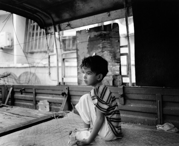 """boy in bed of truck yangon 2013 toned gelatin silver print 40"""" x 49""""   18"""" x 22"""" edition of 3   5"""