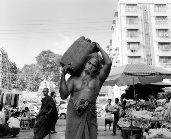 """carrying oil yangon 2013 toned gelatin silver print 40"""" x 49""""   18"""" x 22"""" edition of 3   5"""