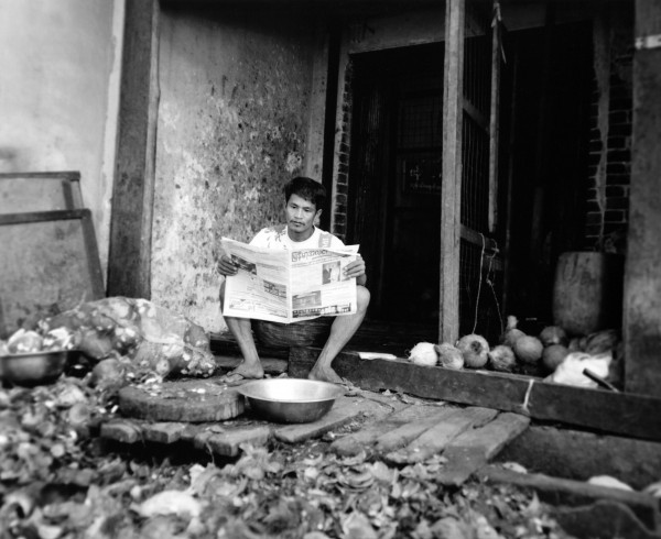 """in the morning, reading the paper  mandalay 2013 toned gelatin silver print 40"""" x 49""""   18"""" x 22"""" edition of 3   5"""