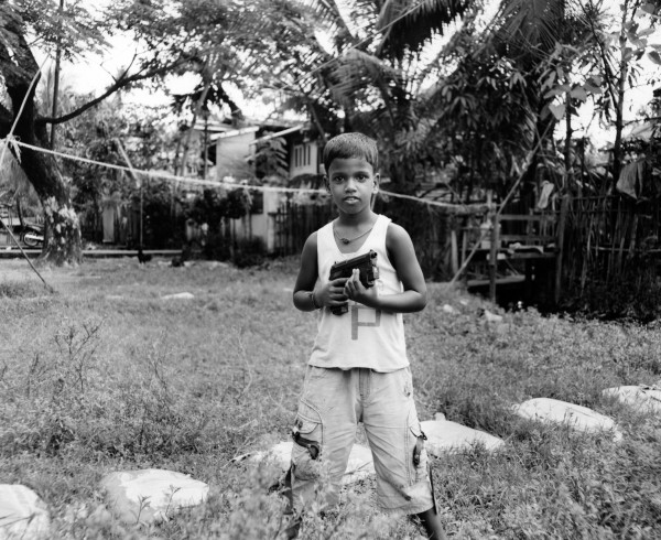 """made in china/boy with gun myanmar 2013 toned gelatin silver print 40"""" x 49""""   18"""" x 22"""" edition of 3   5"""